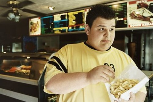 Fat man in take away food store